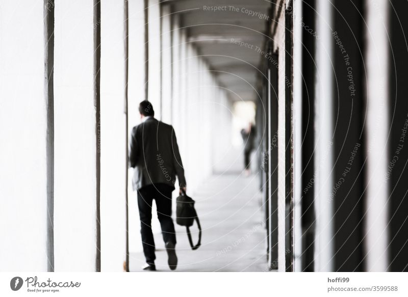 Man goes home after work office portico Arcade laptop Task Computer Business Technology labour Internet Notebook person Modern job Lifestyle more adult