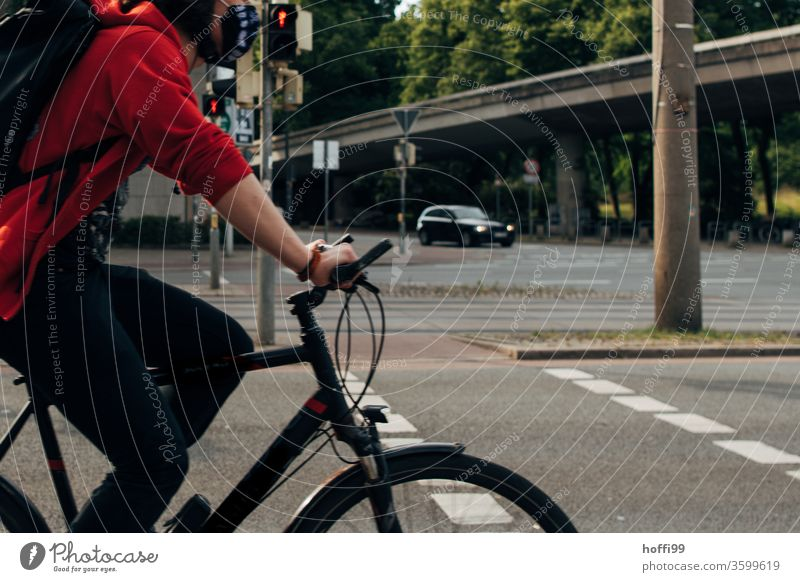 Cyclist rides through image cyclist Cycling Bird's-eye view cycle path Man Street Action Adults Lanes & trails Healthy Exterior shot Sports Bicycle Lifestyle
