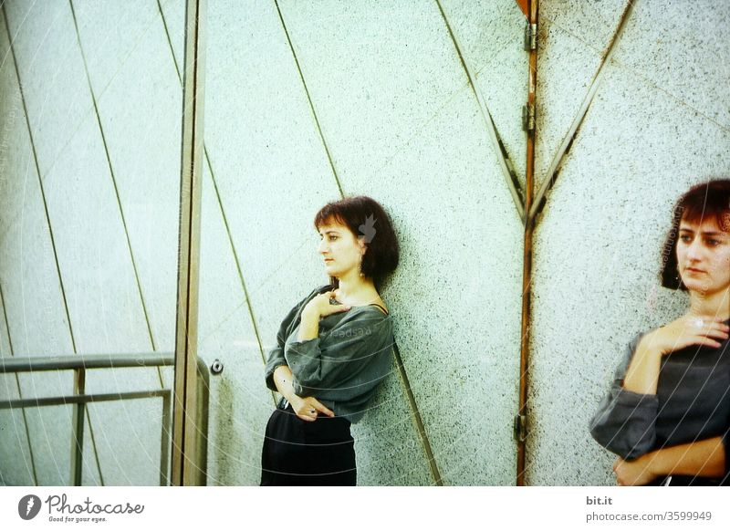 Woman in the mirror Young woman Mirror Mirror image Feminine 18 - 30 years Reflection Adults Doubt Twin mirrored Wall (building) Facade Dream Sadness Posture