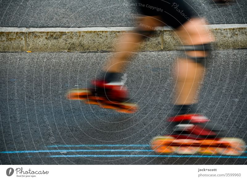 Inline skating between lines on the asphalt Sports Leisure and hobbies Inline skates Curbside Legs motion blur Driving Athletic Knee pads Movement