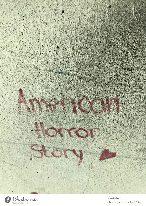 American Horror Story is written in red on a house wall. Politics, USA, crisis. Movie title. Trump American Horror story policy Crisis trump world affairs