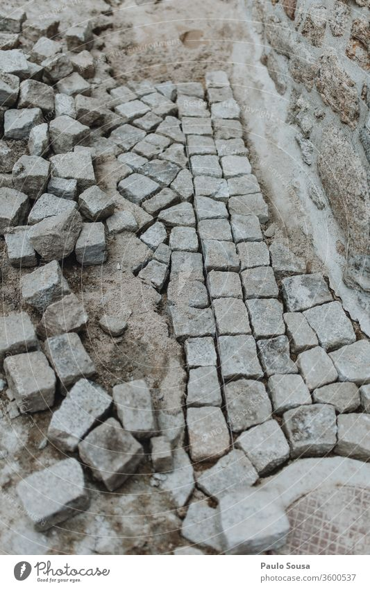 Granite pathway pavement Construction site granite rocks Pavement pavement damages Portugal Paving stone Stone Lanes & trails construction Structures and shapes
