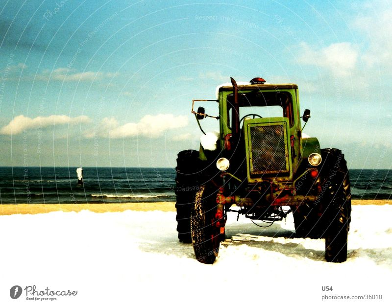 tractive power Tractor Beach Coast Winter Cold Transport Water Sky Sun Snow