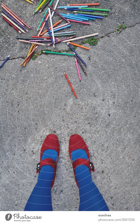 female legs in front of a pile of crayons on asphalt Painting (action, artwork) Draw Heap Muddled dropped Street Asphalt Many Woman feminine Stand Legs foot