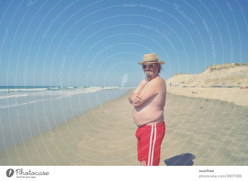 young man on a beach Man vacation Summer Swimming trunks Ocean Atlantic Ocean Sandy beach wide holidays Tourist Holidaymakers Summer vacation Waves