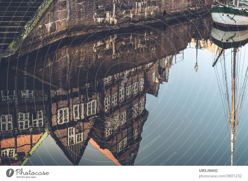 The old half-timbered houses and the mast of the sailing ship are reflected in the water Old town reflection Reflection Town Day quay wall Sailing ship Ewer