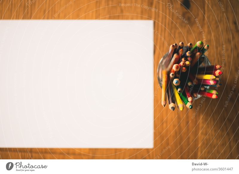 coloured pencils and a white sheet of paper crayons pens colors colourful Painting (action, artwork) creatively Creativity flaked Piece of paper Copy Space
