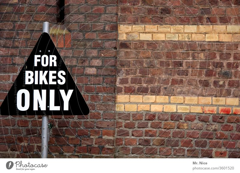only for bikes cycling Cycling Bicycle Leisure and hobbies Signage Road sign Wall (barrier) Wall (building) Parking lot Traffic infrastructure parking space