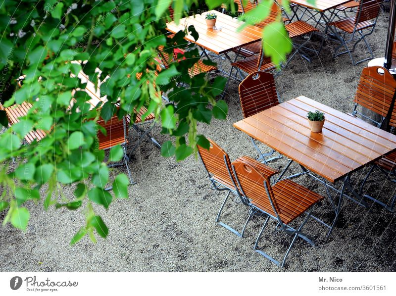 Anticipation I for a beer garden evening without distance rules Going out Table Chair Summer Beer garden Wooden table Café Restaurant Together Regulars Reserved