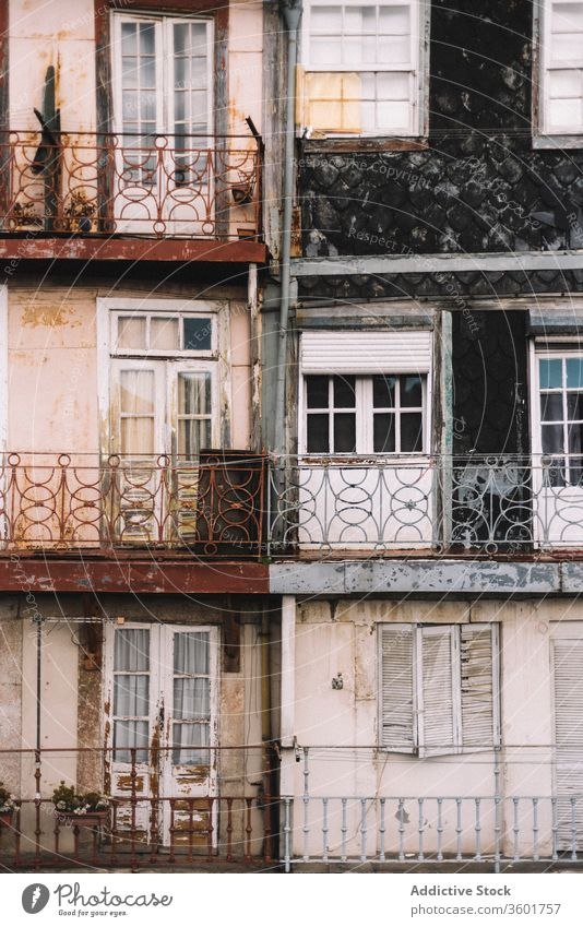 Shabby facade of residential building in city exterior aged house weathered shabby architecture background texture porto portugal construction old metal grunge