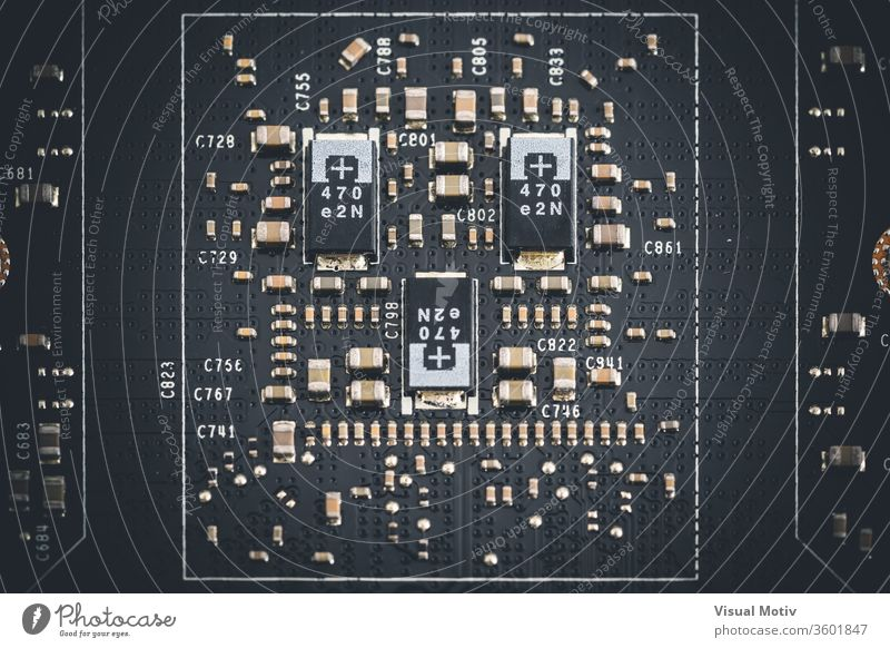 Macro view of electronic components of the printed circuit board of a graphics card macro microchip integrated circuit element metal metallic device