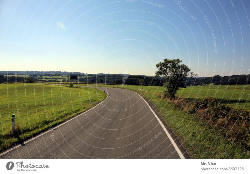 highway Country road Street Traffic infrastructure Lanes & trails Asphalt Environment Curve Landscape Nature Sky Field Meadow Beautiful weather hillock Horizon