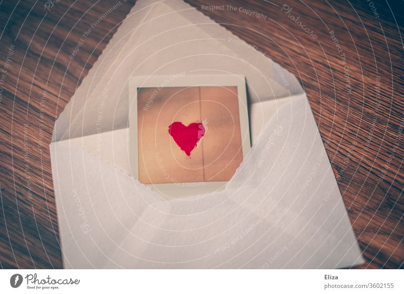Photo with red heart will be sent in an envelope Envelope (Mail) Heart mail Love letter Best wishes In love communication Red Letter (Mail) Write photo Polaroid