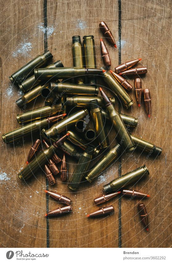 .308 Ammunition with projectiles Flat Lay on board surrounded by powder ammo ammunition armed army association background brass bullet bullets caliber cartridge