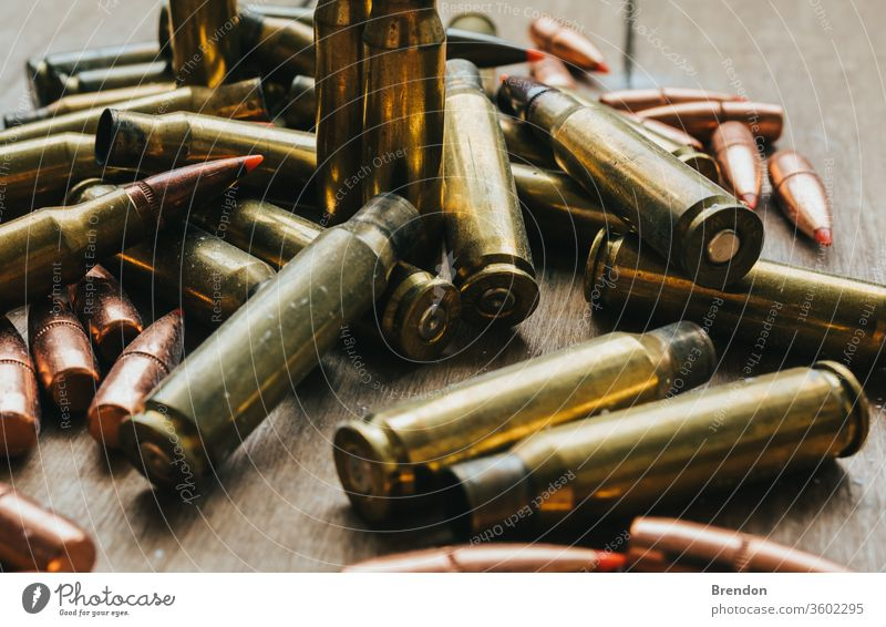 .308 Ammunition with projectiles Flat Lay on board 9mm ammo ammunition armed army association background brass bullet bullets caliber cartridge cartridges