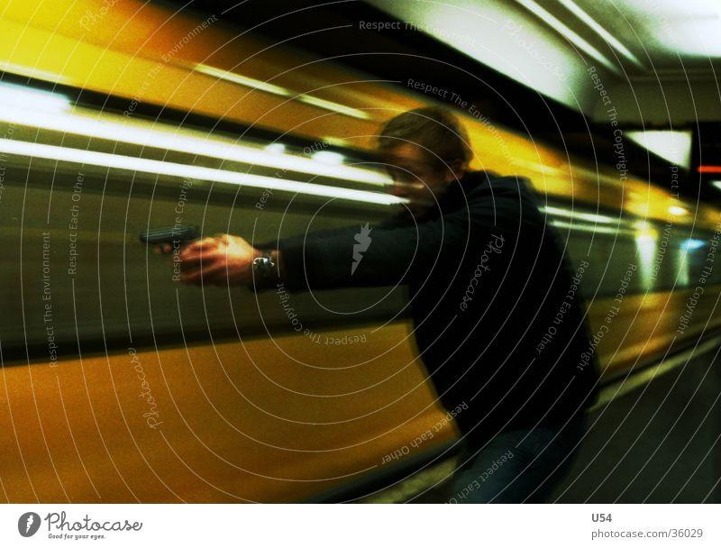 Man Dangerous Threat Target Underground Obscure Handgun Weapon Shot Platform Robbery