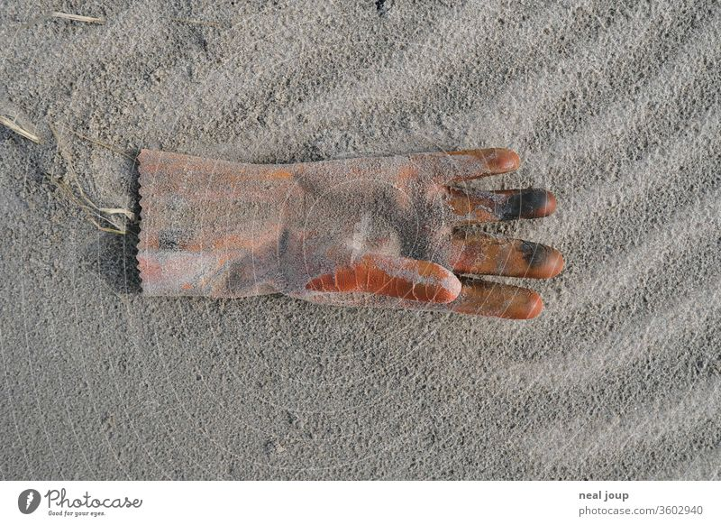 Plastic waste on the beach - Glove orange Environmental pollution plastic Rubber Trash Ocean Beach Sand Coast Recycling Problem Nature dirt Shackled ecologic