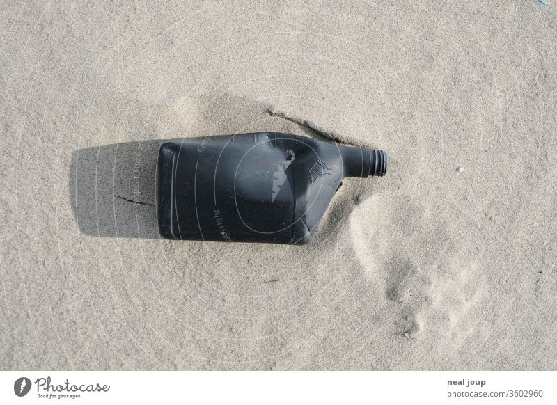 Plastic waste on the beach - jerry can, black Environmental pollution plastic Rubber Trash Ocean Beach Coast Recycling Problem Nature dirt Shackled ecologic