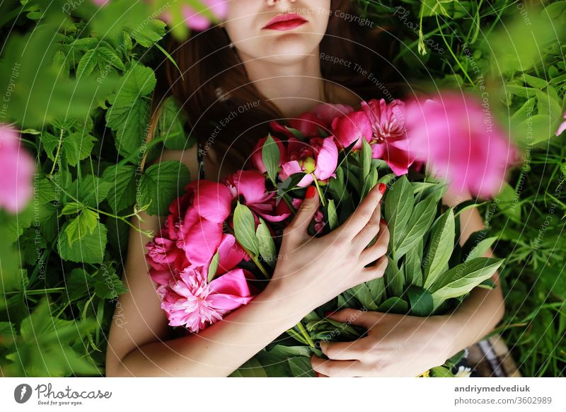 Bouquet of Peony. beautiful young woman lies among peonies. Holidays and Events. Valentine's Day. Spring blossom. flowers peony portrait glamour pink romantic