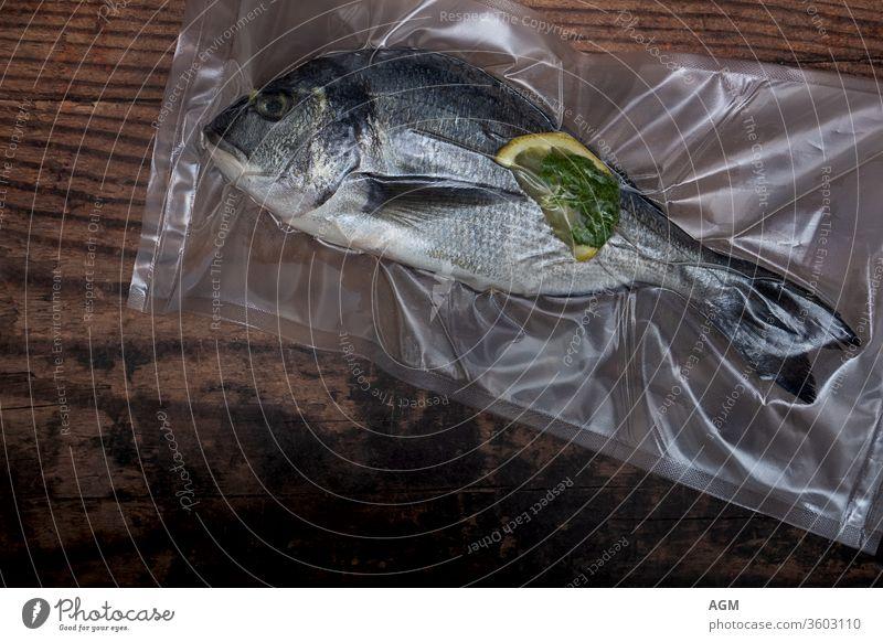 Dorade vacuumed for sous vide Food airtight bag clean eating cooking copy-space diet dorado fish flat lay fresh fresh fish garlic gourmet healthy home made