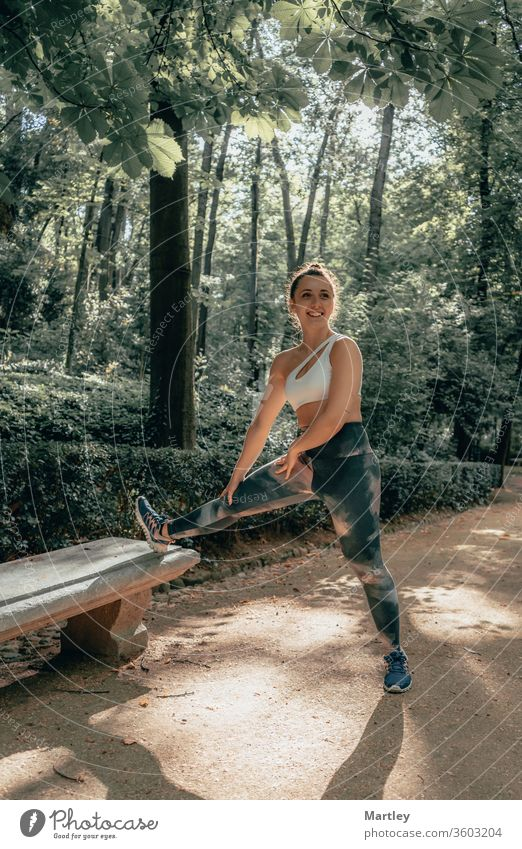 Young pretty sportswoman with leggings smiling and enjoying sports in a forest with fresh air in summer. nature smiling woman child young outdoors exercise