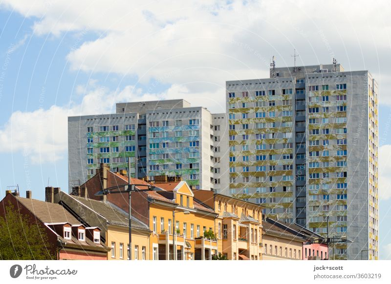 Old before new building Facade Prefab construction Architecture Lichtenberg Sunlight Style Old building Urban development Sky Clouds Gloomy Tower block