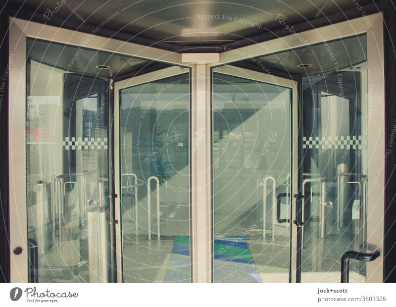 in front of the revolving door Is everything ready Glass Revolving door Entrance Way out Handle Business Foyer strategy Arrangement Structures and shapes Pane