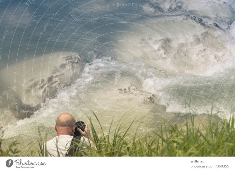 bald man takes pictures of rapids at the river Leisure and hobbies Take a photo Photography Photographer Man Adults Human being Nature Water Grass River bank