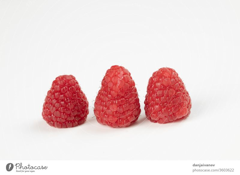 Raspberry fruits on a white background raspberry food red raspberries isolated fresh ripe healthy sweet juicy dessert diet delicious freshness closeup summer