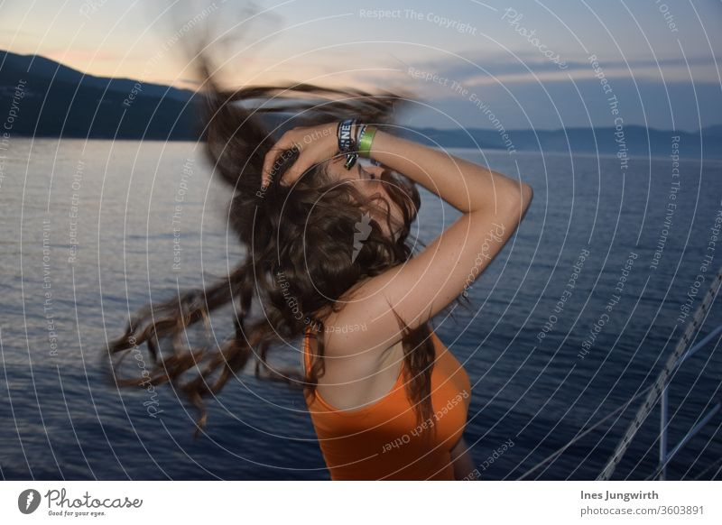 Hair Throwing Moment hair in the wind Hair and hairstyles Croatia Tourism already Calm Mediterranean Horizon Exterior shot Vantage point Landscape Deserted Bay