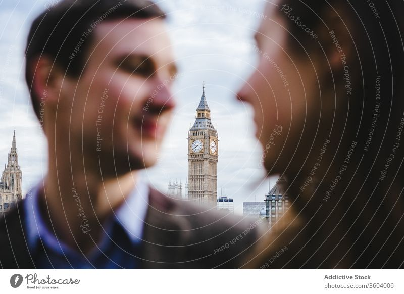 Couple in love during city stroll couple big ben street relationship clock tower together london england united kingdom smile romantic content enjoy landmark