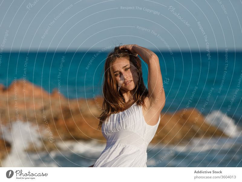 Tender woman in white dress at seashore in summer vacation tender beach seascape holiday enjoy female serene turquoise water sunny weather ocean relax tranquil