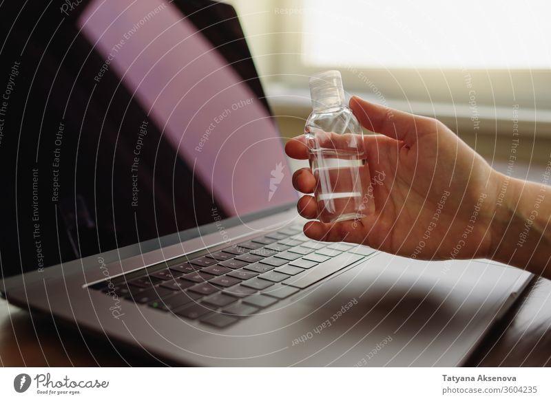 Using Hand sanitizer on working desk hygiene dispenser liquid hand bottle health gel quarantine antibacterial clean wash hygienic disinfectant sanitary cleanser