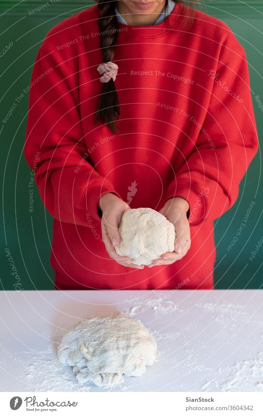 Woman prepares to her home handmade dough for bread, homemade cooking. woman hands white person powder pie pasta working bake-house food pizza female pastry raw
