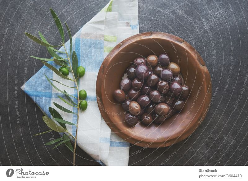 Olives in vintage plate olive oil olives background virgin extra rustic wood greek healthy cooking food home italian ingredient raw spanish concept nature green