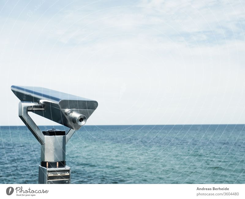 Binoculars on a pier, concept for far-sightedness or look into the future vision farsightedness city background european shore binoculars business famous