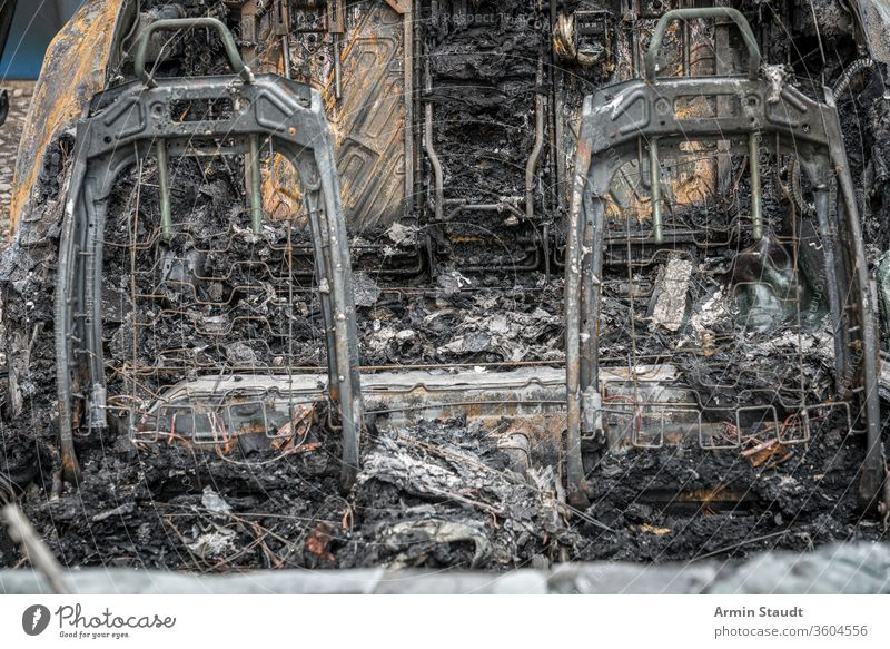 the frame of two car seats of a burnt-out car accident attack background berlin blaze broken burned burning city crime damage danger dangerous destroyed