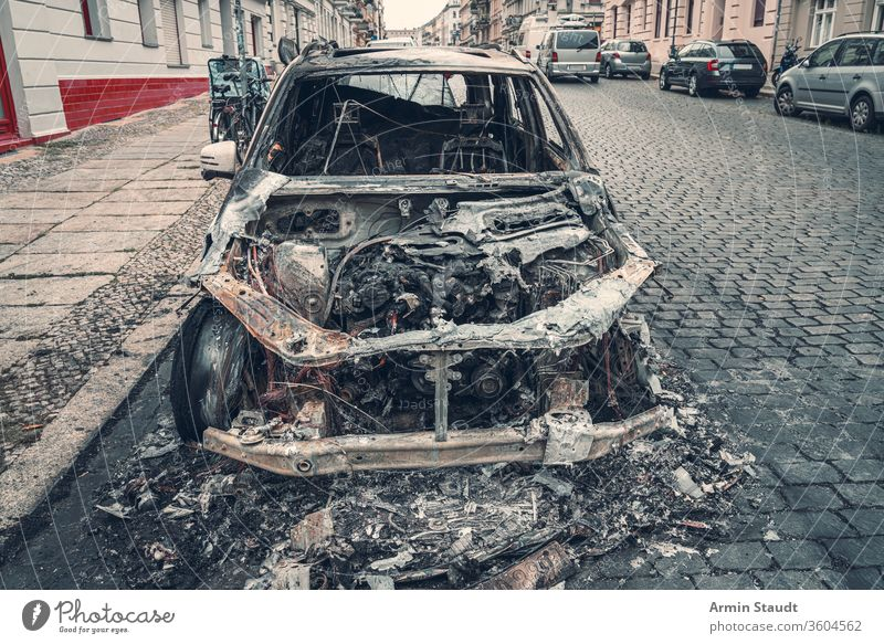 burnt out car in the streets of berlin accident attack background blaze broken burned burning city crime damage danger dangerous destroyed destruction emergency