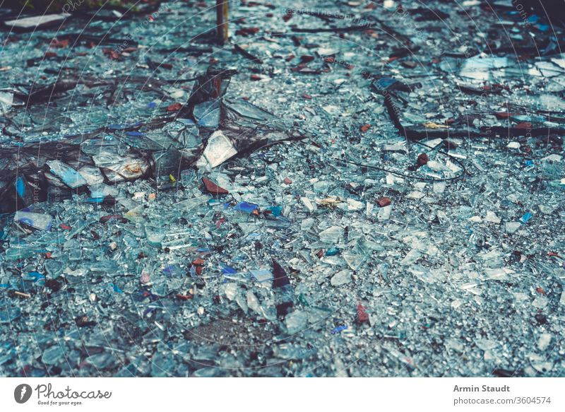 close up of colorful glass shards covering the ground cracked crushed damage abstract accident background break broken crash debris destruction dust earth