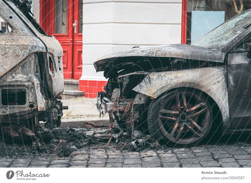 Burned out cars in the streets of Berlin accident attack background berlin blaze broken burn burned burning city crime damage danger dangerous destroyed