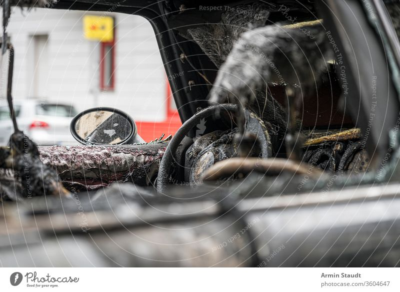 melted steering wheel of a burnt out car accident attack background berlin blaze broken burned burning city crime damage danger dangerous destroyed destruction