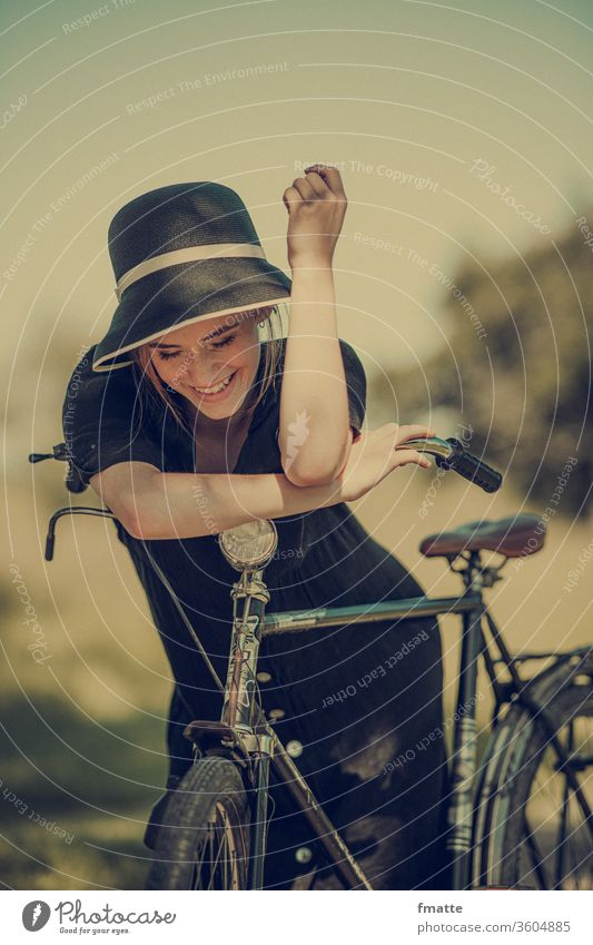 Woman with bicycle Wheel Bicycle Joy glad Summer vacation voyage Free luck relaxation Exterior shot Vacation & Travel Leisure and hobbies Cycling smile Healthy