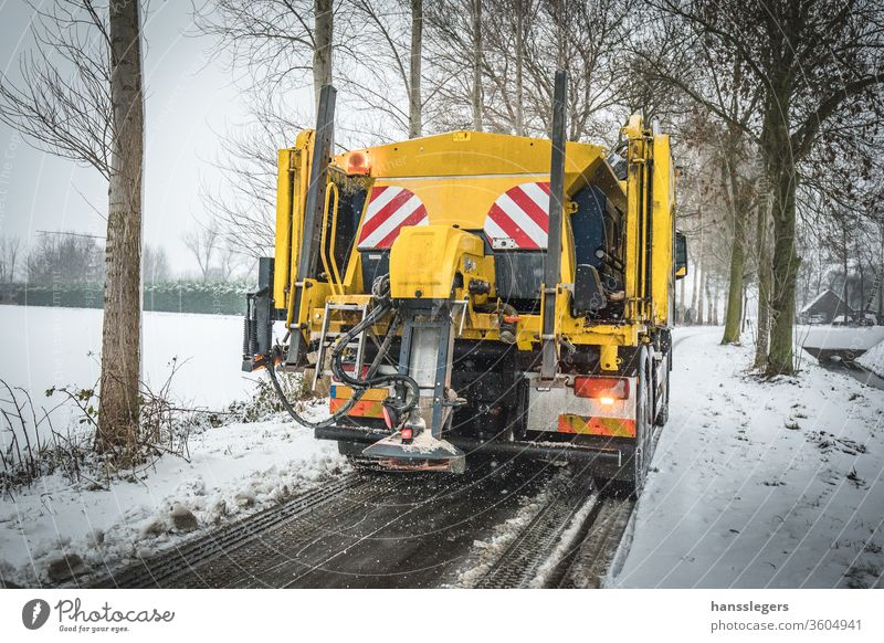 Winter service truck spreading salt on road snowplow plowing blizzard winter clean snowfall cold clear icy removal storm tractor snowstorm vehicle equipment