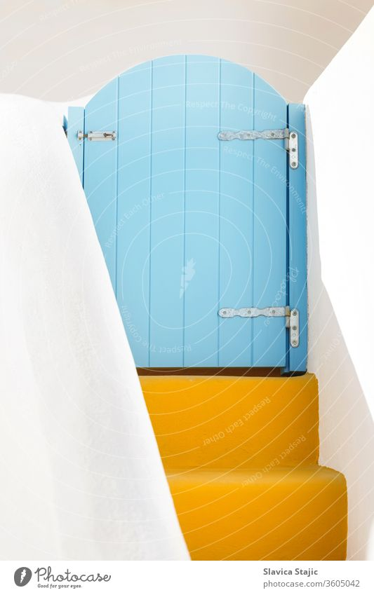 Small blue door and yellow steps on Santorini island, Greece arch architecture background closed cyclades design destination details elements entrance europe