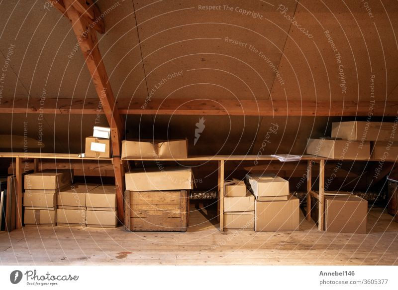 Old wooden attic interior with old cardboard boxes for storage or moving, family grunge frame retro house vintage couple home fun happy indoors