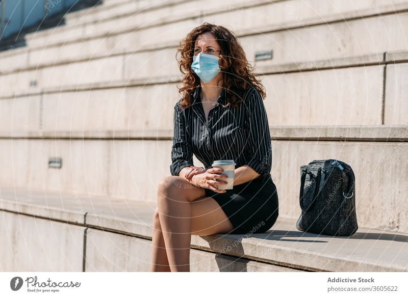 Business woman having a coffee break in the city. business people cafe female cup drink street lifestyle sitting adult person urban businesswoman beautiful