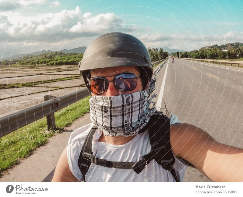 A tourist stops for a selfie during a motorcycle tour in Vietnam Car journey Motorcycle Trip Tourist Tourism voyager Wanderlust Adventure Selfie