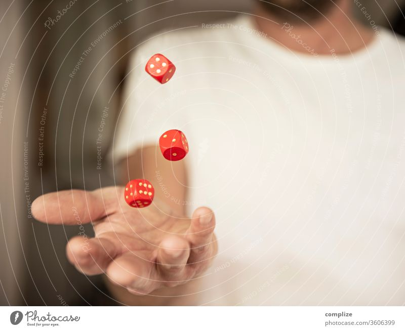 Man throws dice in the air luck Playing Poker Table Success Financial Industry Stock market Adults by hand wood Digits and numbers Throw Hope Dangerous