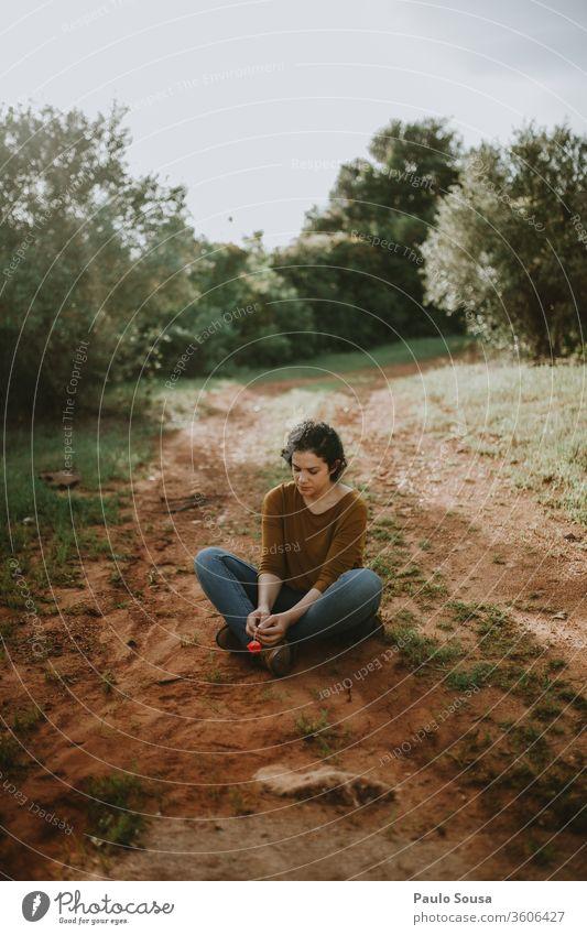 Woman Sitting On Dirt Road sitting sitting on floor road waiting Wait female Loneliness Feminine Relaxation woman legs alone Lovesickness travel thinking