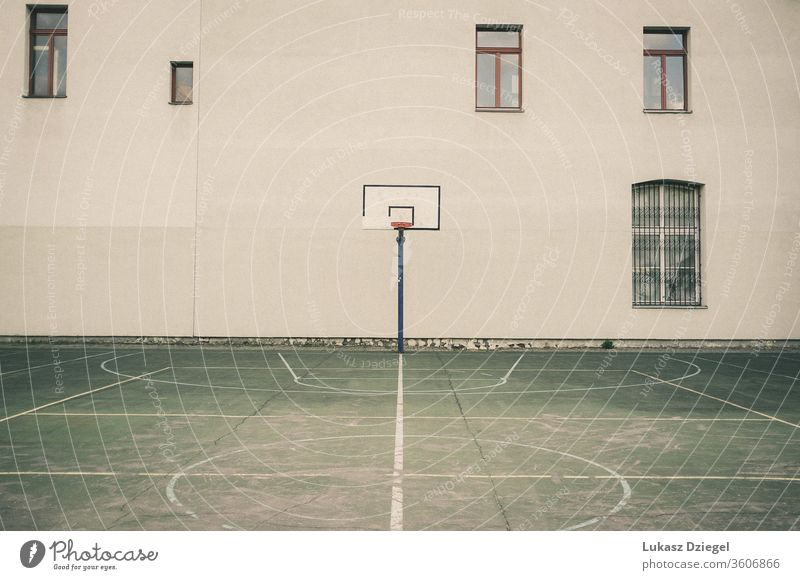 Urban basketball court without people architectural architecture asphalt athletics background board brick building challenge cinematic city compete competition